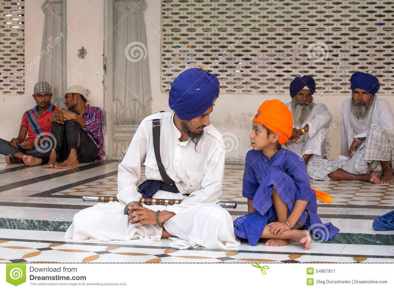 sikh-man-boy-visiting-golden-temple-amritsar-punjab-india-september-unidentified-pilgrims-travel-54867811[1]