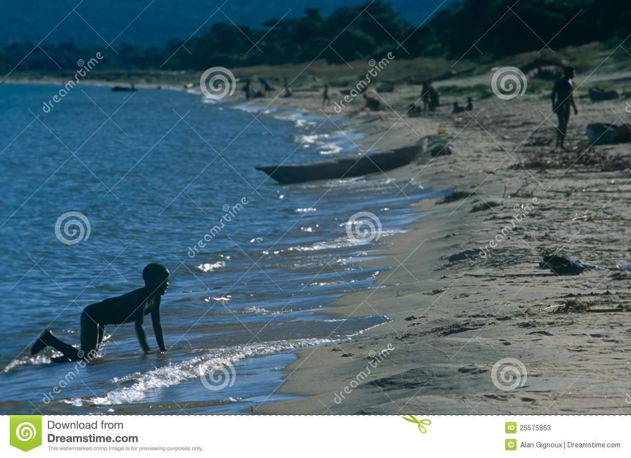 child-playing-beach-lake-malawi-25575863[1]